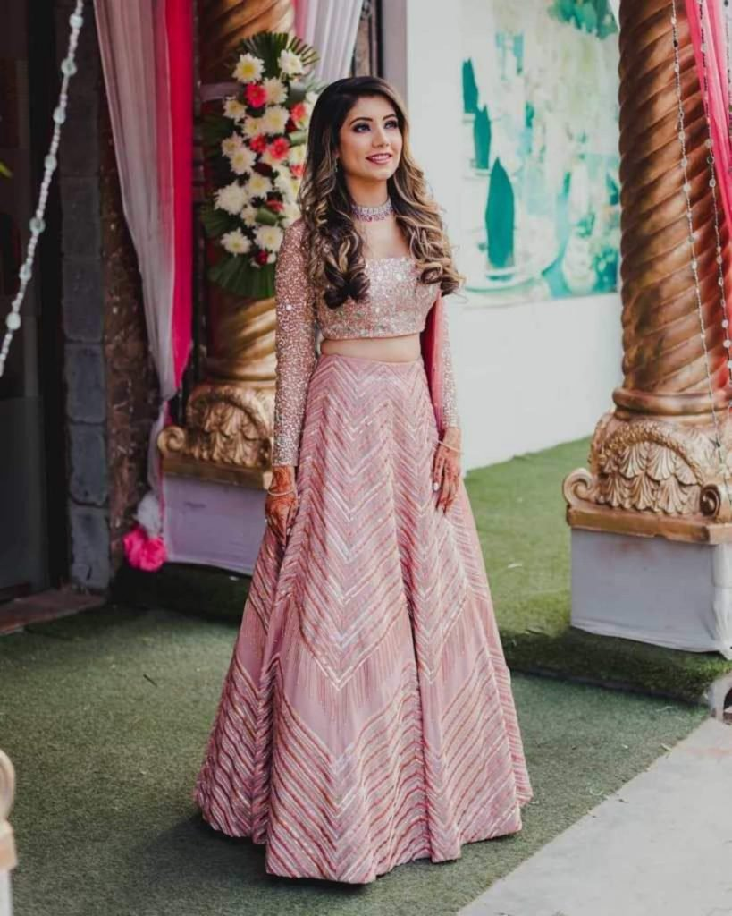 blush pink lehenga with chevron design for sister of bride and groom
