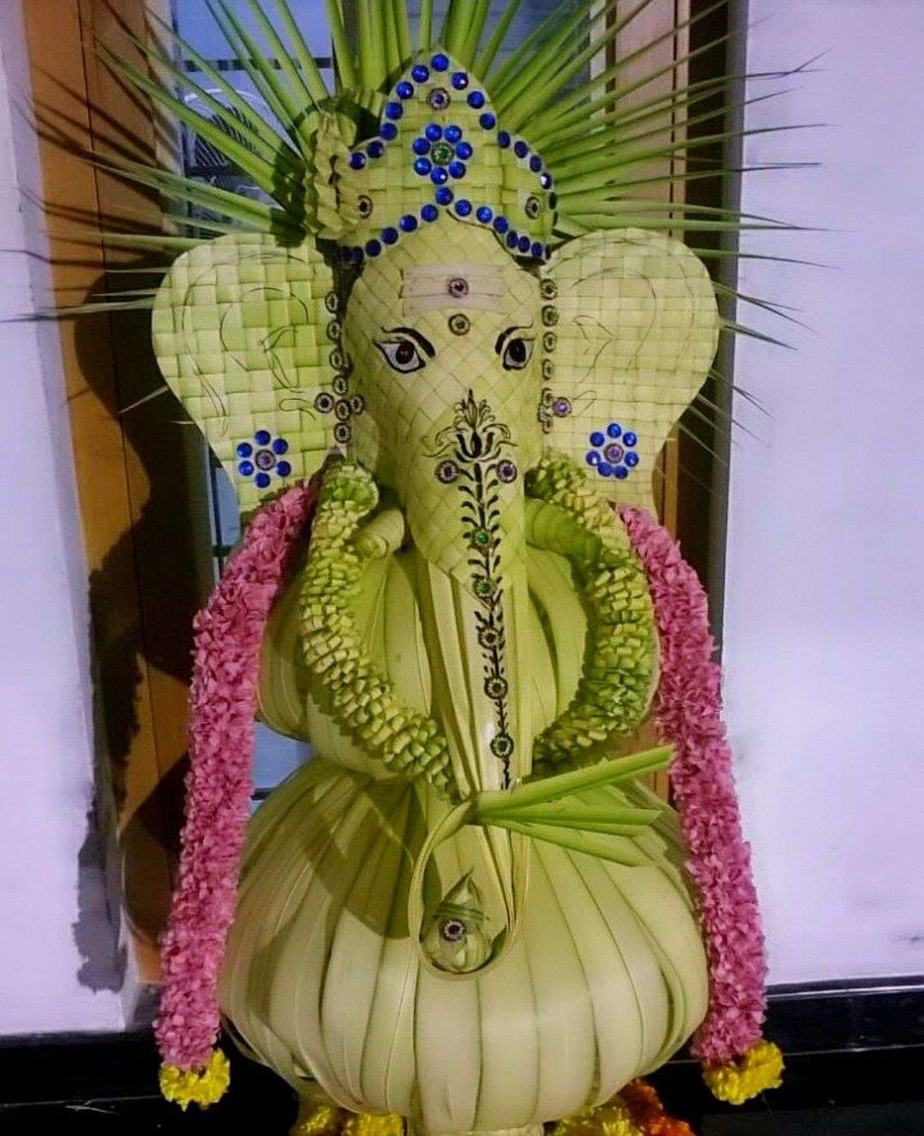 ganesh puja decoration with the help of paan leaves