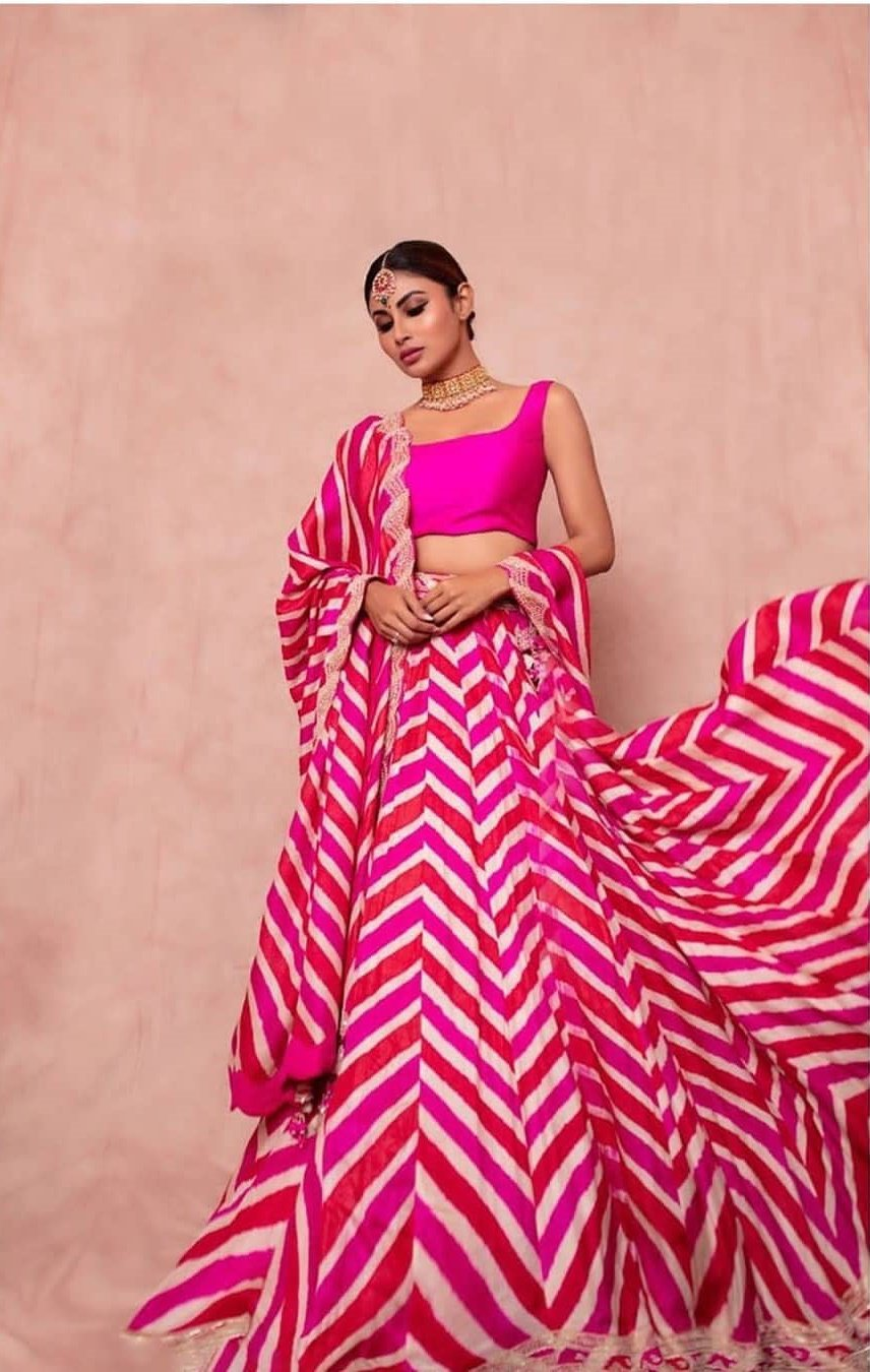 Mouni Roy in a Chevron Pattern Bandhni-Magenta-Lehenga