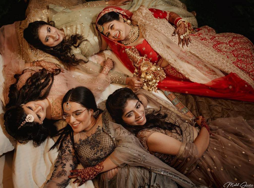 Heads-Uniting-Moments of bride with bridesmaid