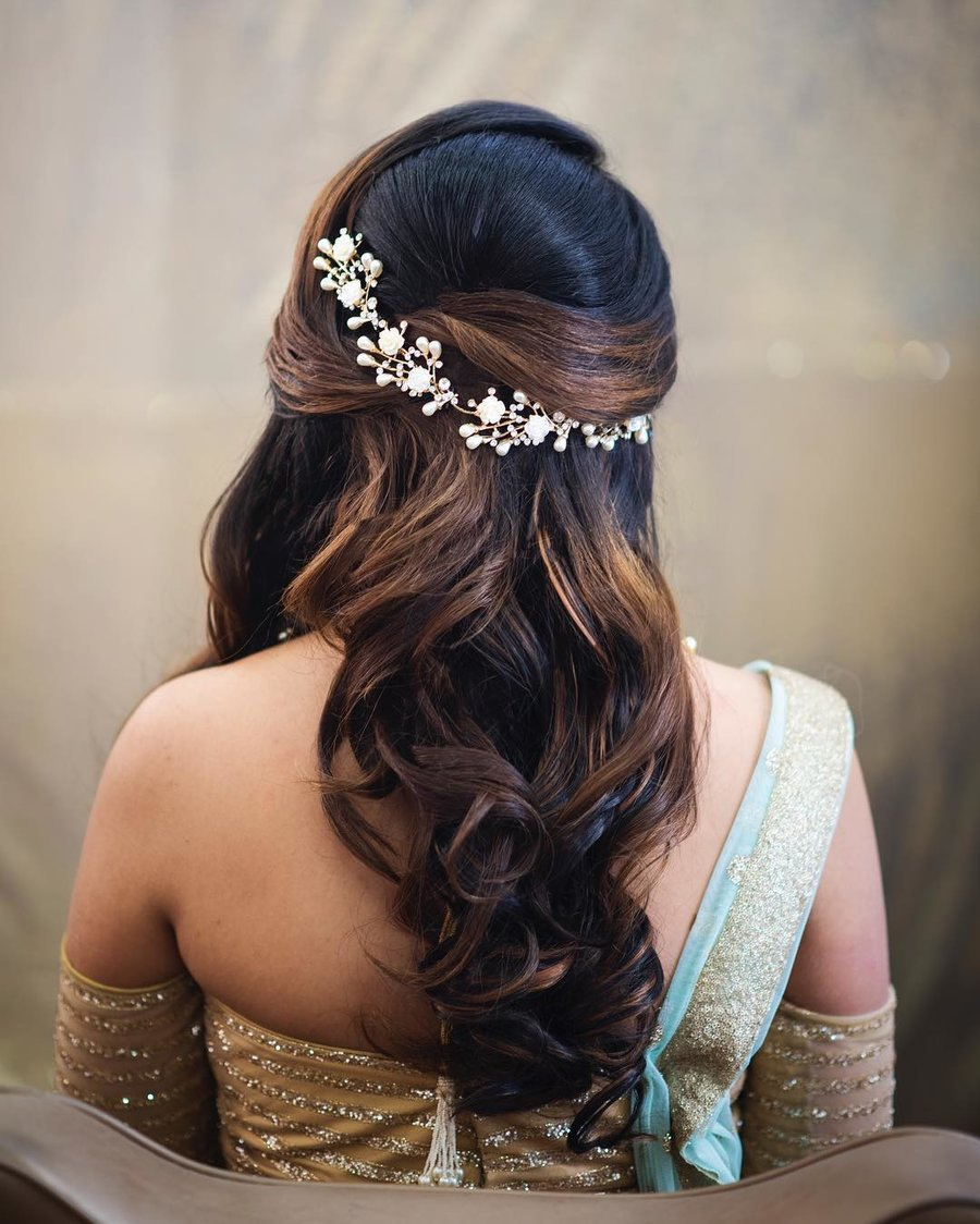 half tie hairdo for the engagement function